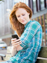 Urban Communication - Woman Texting Royalty Free Stock Photo