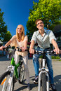 Urban couple riding bike in free time in city Stock Photos