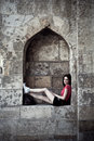 Urban girl at fortress Royalty Free Stock Photo