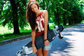 Urban girl with longboard outdoors in summer Stock Photography