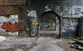 Urban graffiti on a manchester row of arches dereliction an old disused mill in the hart the city england Stock Photo