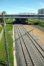 Urban industrial landscape railroad tracks and platform on sunny summer day Royalty Free Stock Photo