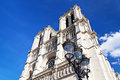 Urban lantern and cathedral notre dame de paris towers of Stock Photos