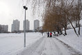 Urban life in winter. Two mothers walk with strollers Royalty Free Stock Photo