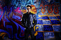 Urban man in front of graffiti wall photo an a colorful Royalty Free Stock Images