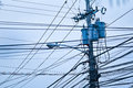 Urban mess electricity cables creating a in a zone Royalty Free Stock Photography
