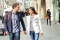 Urban modern professionals couple walking romantic laughing talking holding hands on date young multicultural asian and Royalty Free Stock Photography