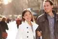 Urban modern young professionals couple walking romantic laughing talking holding hands on date multicultural asian Royalty Free Stock Photos