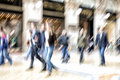 Urban move, people walking in city, motion blur, zoom effect Royalty Free Stock Photo