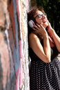 Urban music a vintage dressed girl listing to in a environment Royalty Free Stock Photo