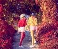 Urban Outdoor. Woman Walking in Park. Fall Fashion Royalty Free Stock Photo