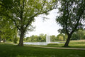 Urban parc with fountain city pond and spraying water Royalty Free Stock Photo