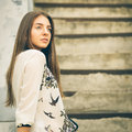 Urban portrait of young hipster girl on stairs Royalty Free Stock Photo