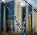 Urban razor wire close up of fence protecting government buildings Stock Images