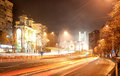 Urban road at night with traffic signs and traffic lights Stock Photography