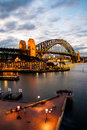 Urban scene of sydney harbour with the harbour bridge australia july at dusk travelers are enjoying night view Royalty Free Stock Images