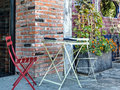 Urban sidewalk seating colorful outside a city restaurant Royalty Free Stock Images