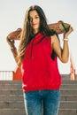 Urban skate girl with skateboard. Royalty Free Stock Photo