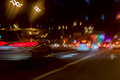 Urban street night traffic with bokeh lights. Blurred auto with bright brake lights, city street lights and speed Royalty Free Stock Photo