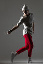 Urban style cool dancer guy portrait of one attractive fit young man warming up dancing wearing casual red pants and beanie Royalty Free Stock Photography