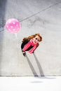 Urban sunny portrait bright happy woman holding a balloon and posing Royalty Free Stock Photos