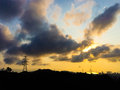 Urban sunset high voltage power lines Royalty Free Stock Photography