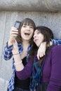 Urban teen girls taking photo by mobile phone Royalty Free Stock Photo