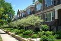 Urban town homes with community sidewalk Royalty Free Stock Image