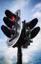 Urban traffic light above the sky red stop signal for cars and green pedestrian on Stock Photo