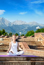 Urban Yoga meditation in ardha padmasana Stock Photography
