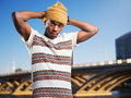 Urban youth in front of city posing portrait an african american Royalty Free Stock Images