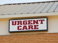 Urgent care clinic sign red and white Royalty Free Stock Images