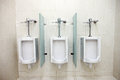 Urinals in men's bathrooms. Royalty Free Stock Photo