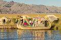 UROS, PERU - JULY 29 2012: Family living on floating reed island Uros at lake Titicaca Peru Bolivia Royalty Free Stock Photo