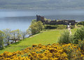 Urquhart castle on loch ness scotland in a summer s day view of with the mountains of the scottish highlands Royalty Free Stock Photography