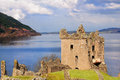 Urquhart castle in scotland on loch ness the home of the clan grant and the place of the most sightings of nessy the famous loch Royalty Free Stock Image