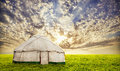 Urta nomadic house in steppe on the grass field at sunset evening sky central asia Stock Photo