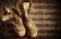 Us army boots on the old paper flag background vintage textured Royalty Free Stock Photography