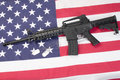 Us army carbine with blank dog tags on us flag Stock Photo