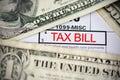 US dollar bills on tax bill suggesting tax payment Royalty Free Stock Photo