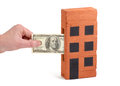 US Dollar deposit into a house-brick Royalty Free Stock Photos