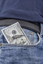Us dollar note in a pocket the front of pair of blue jeans usd Stock Image