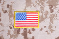 Us flag on camouflage uniform Royalty Free Stock Photos