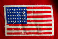 Us flag sewed on a pair or red jeans Royalty Free Stock Photos