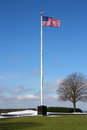 Us flag the stars stripes flying over american military cemetery Stock Images