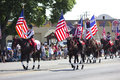 Us flags in patriotic parade taken during th of july rexburg idaho Stock Image