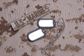 Us marines concept with service tapes dog tags and camouflaged uniform Stock Photos