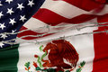 US and Mexican flags separated by barbed wire Royalty Free Stock Photo