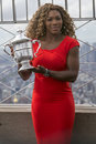 Us open champion serena williams posing with us open trophy on the top of empire state building new york city september Stock Photos