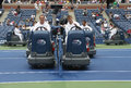 US Open cleaning crew drying tennis court after rain delay at Arthur Ashe Stadium Royalty Free Stock Photo